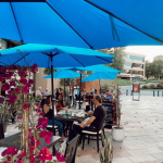 blue umbrellas over outdoor tables